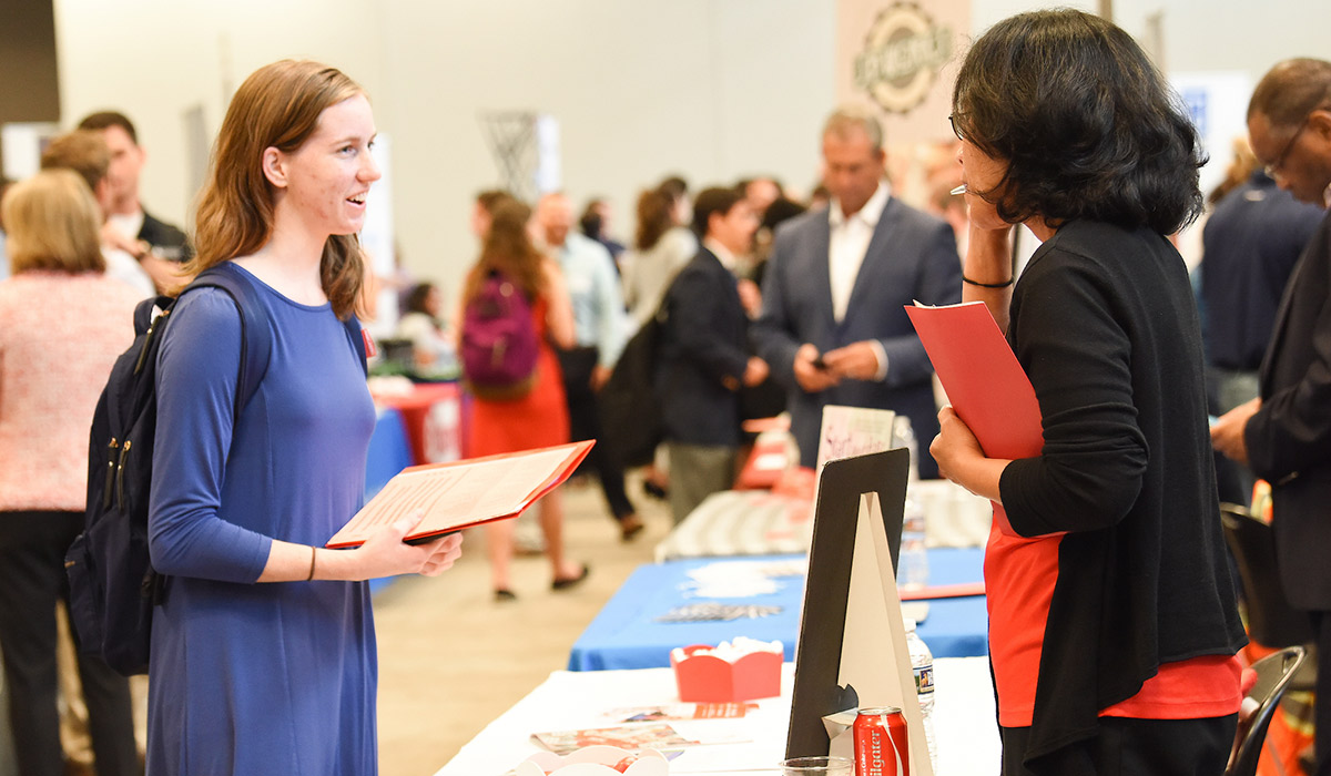Student and Employer talking at a job fair